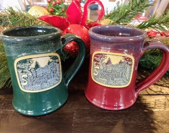 Green and burgundy ceramic mugs with a beige medallion of the front of the Sheridan House Inn