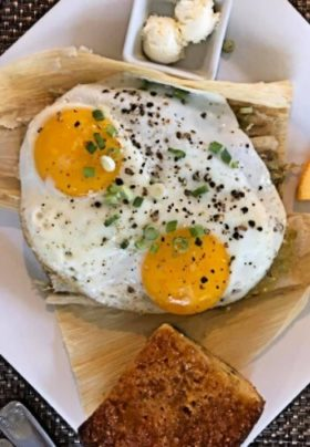 Sunny side eggs on top of tamales with cornbread