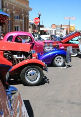 antique colored cars at car show